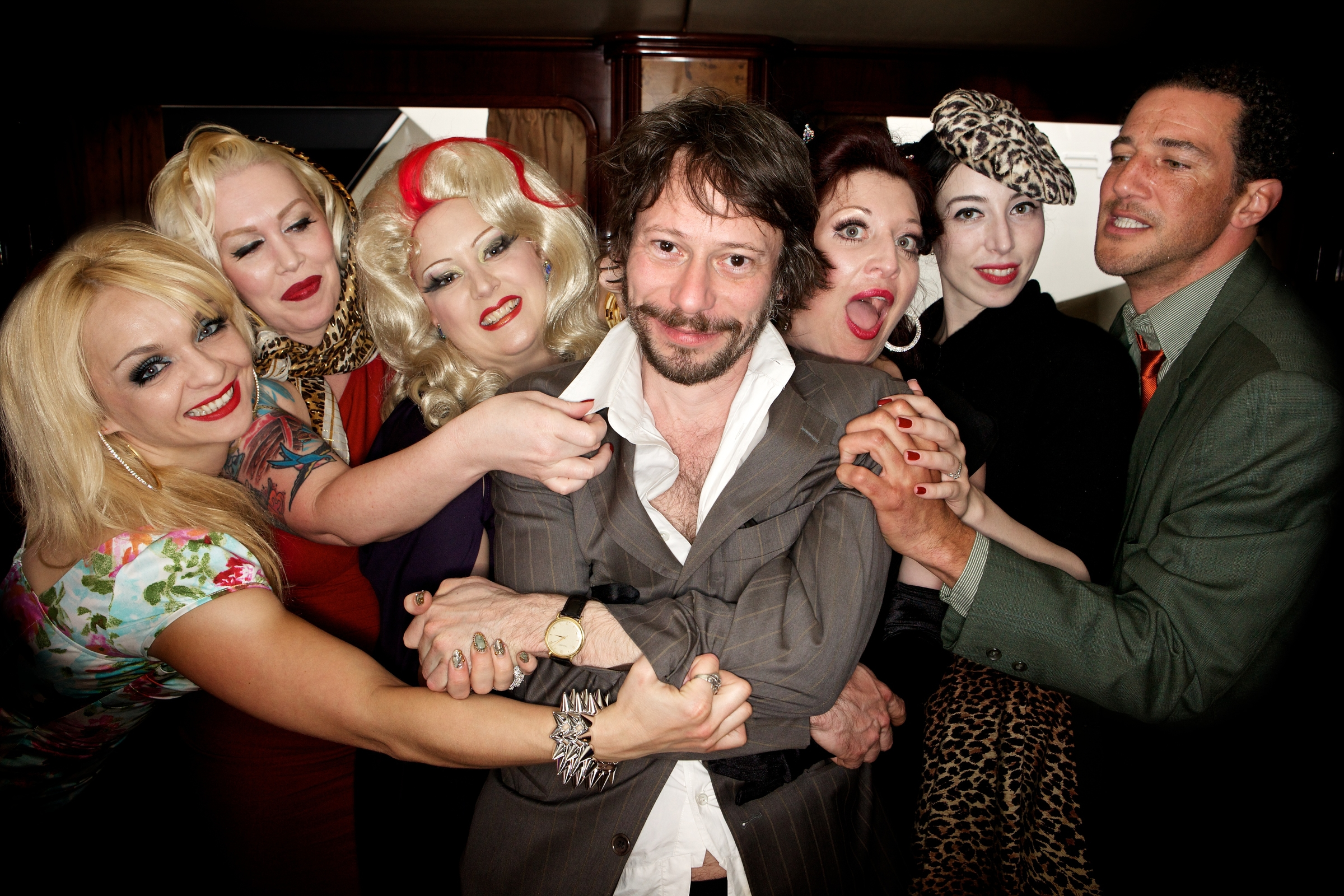"French film director and actor Mathieu Amalric, surrounded by his cast, from left, Julie Atlas Muz, Mimi Le Meaux, Dirty Martini, Kitten On The Keys, Evie Lovelle and Roky Roulette. Their Film ""Tournée"" was presented at the 63rd Cannes Film Festival."